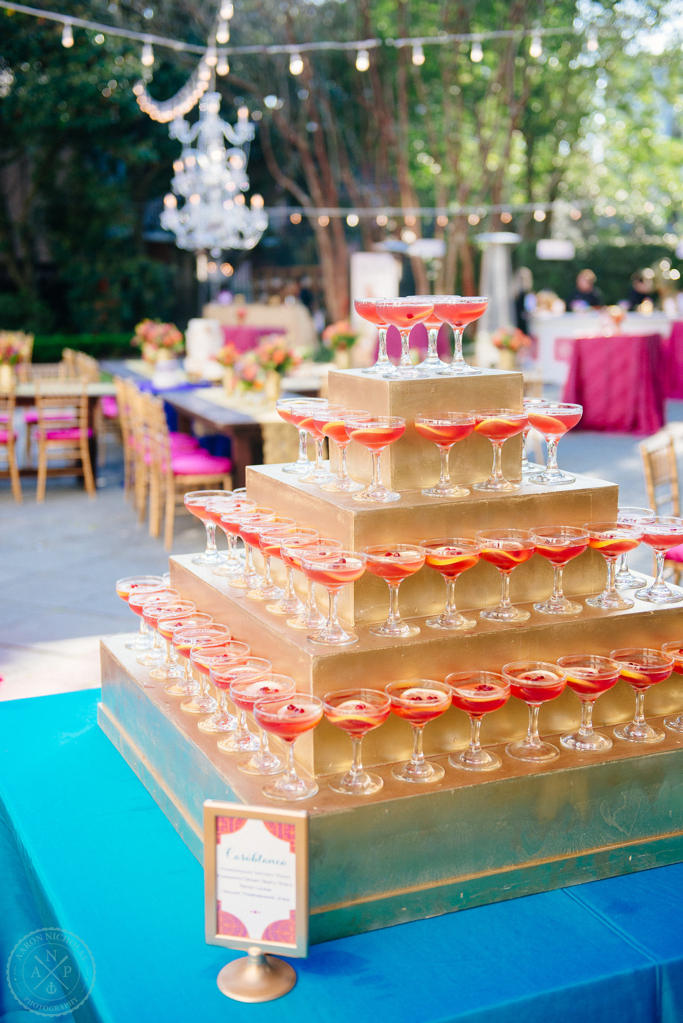 casablanca-style-champange-pyramid-with-sangria-moroccan-inspired-garden-wedding-reception-fuchsia-blue-orange-details