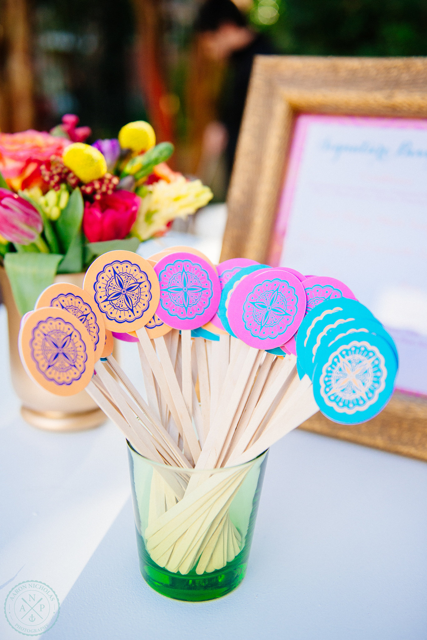 the-knot-market-mixer-drink-stirs-orange-fuchsia-teal-wedding-theme-moroccan