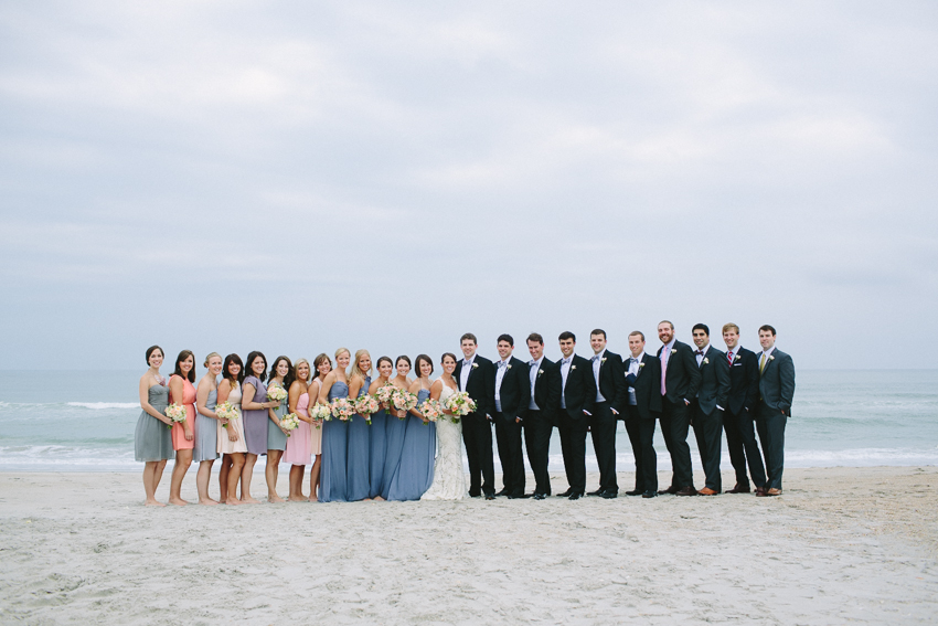 wedding-party-on-the-beach-mulit-colored-bridesmaids-dresses-each-wearing-different-color