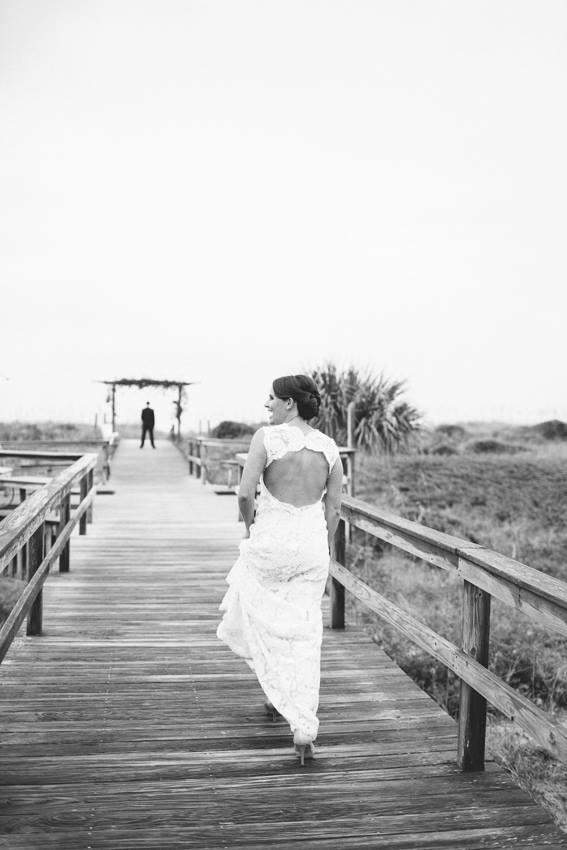 bride-walking-to-groom-for-first-look-wrightsville-beach-wedding-painter-ben-keys