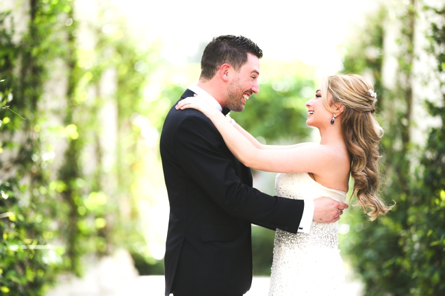 the-breakers-wedding-carolina-herrera-gown-bride-with-loose-curls-swarovski-belt