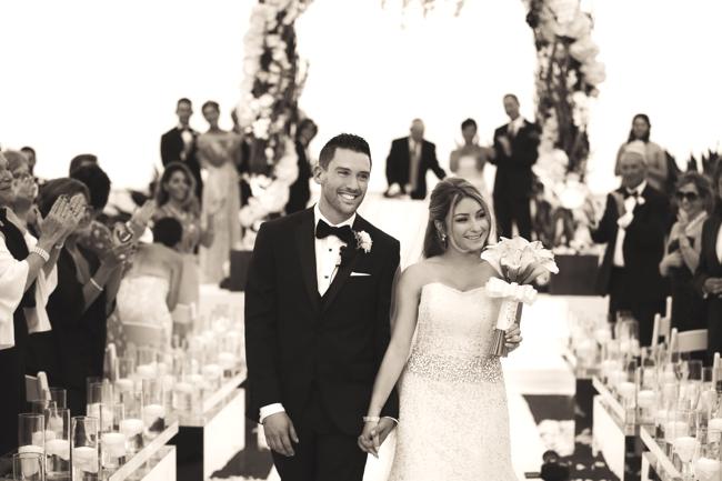 the-breakers-palm-beach-bride-carolina-herrera-sara-renee-events-miami-groom-candle-aisle-chuppah-on-the-beach
