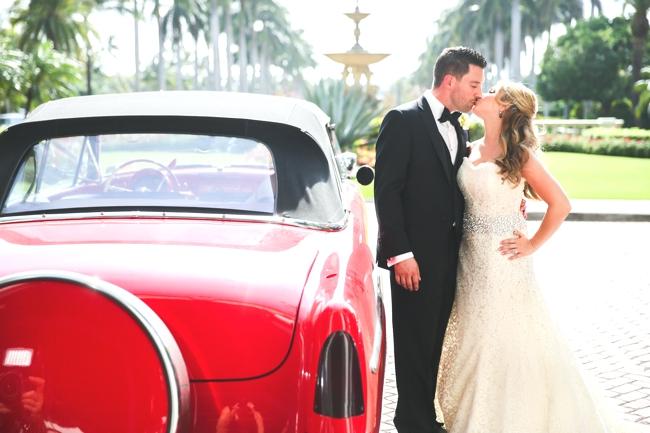 red-getaway-car-the-breakers-luxury-wedding-palm-beach-convertible-carolina-herrera-donna-newman