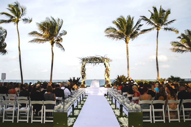 luxury-wedding-the-breakers-hotel-palm-beach-florida-candle-aisle-with-white-carpet-beach-wedding-artist-ben-keys-wed-on-canvas