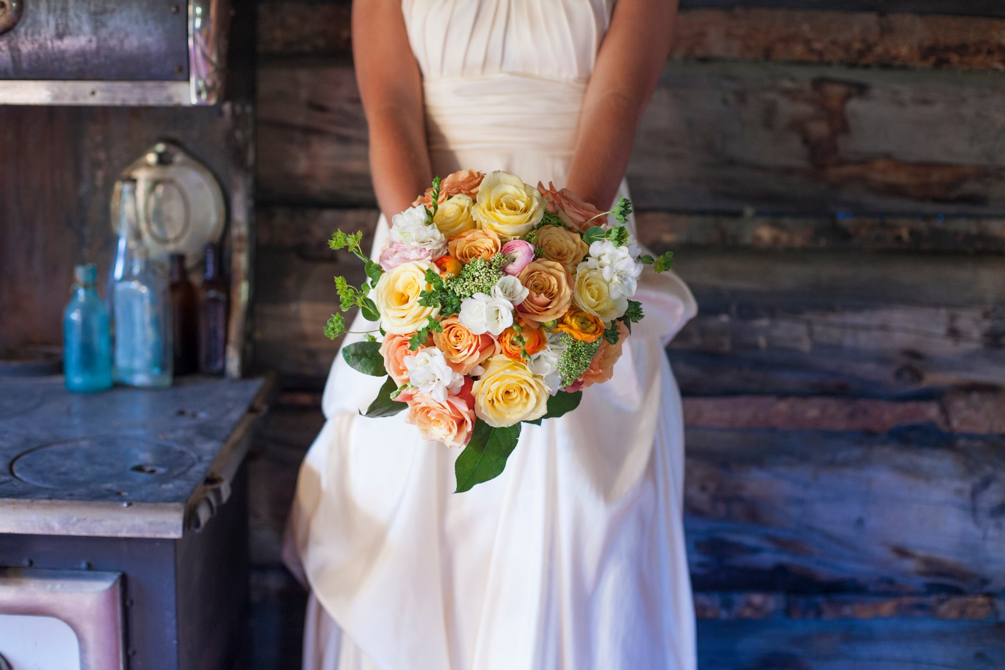 july-4th-wedding-breckenridge-dry-gulch-placer-wedding-painter-yellow-and-and-orange-rose-bouquet-rustic-wedding
