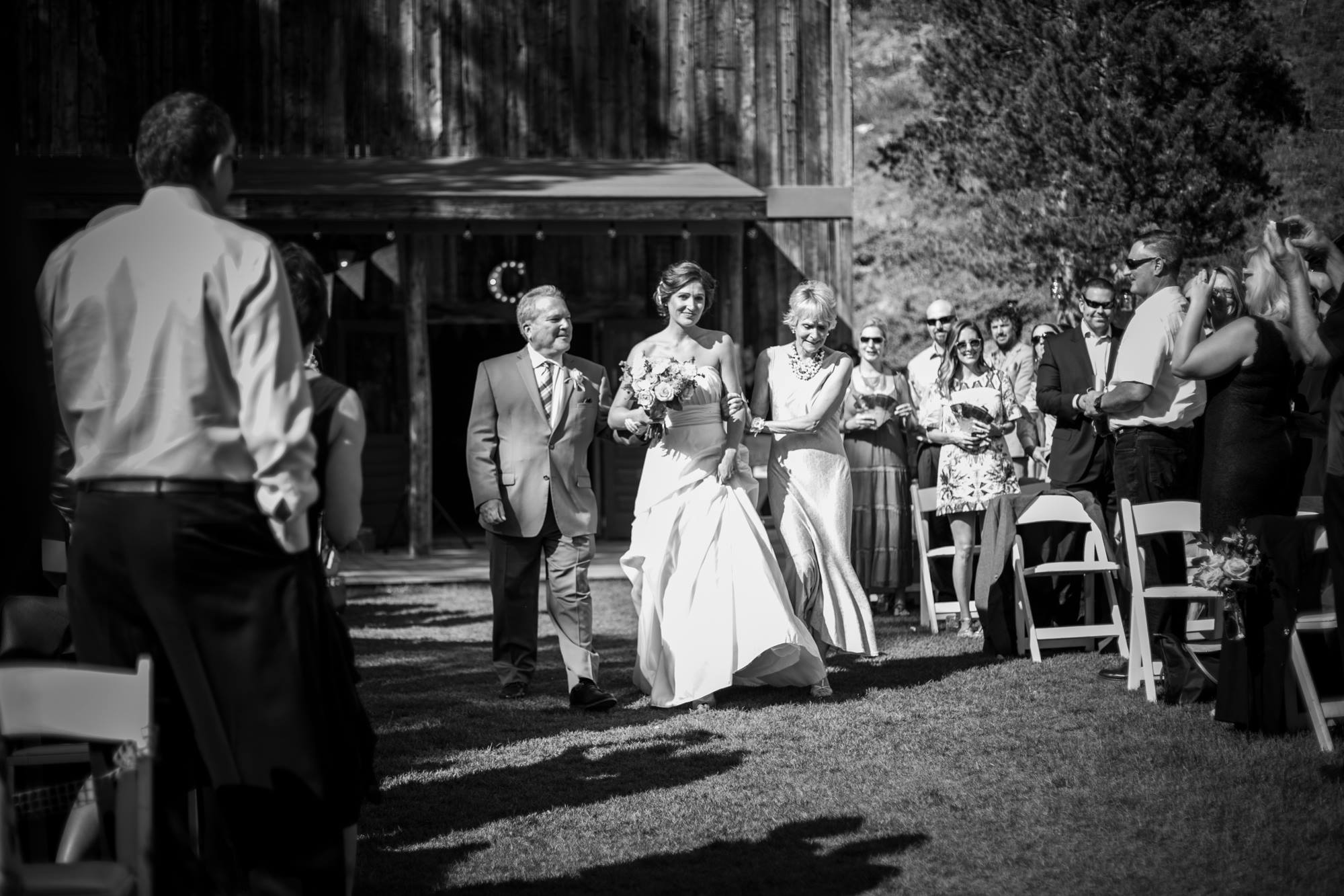 mother-and-father-walking-bride-down-the-aisle