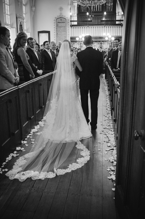 petals-lining-church-pews-charleston-wedding-artist-ben-keys