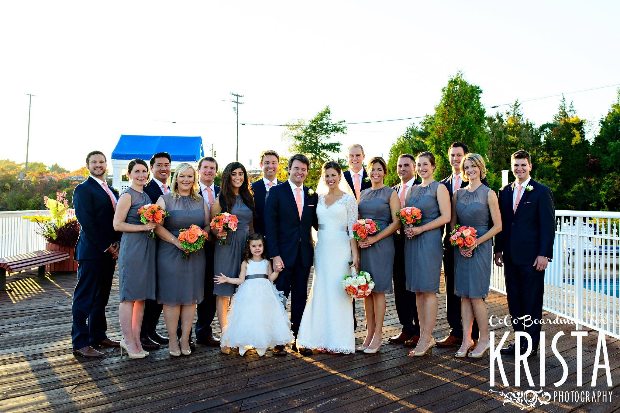wedding-party-photo-on-dock-wed-on-canvas-coral-bridal-bouquet-gray-bridesmaid-dresses-wentworth-by-the-sea-wedding-ben-keys