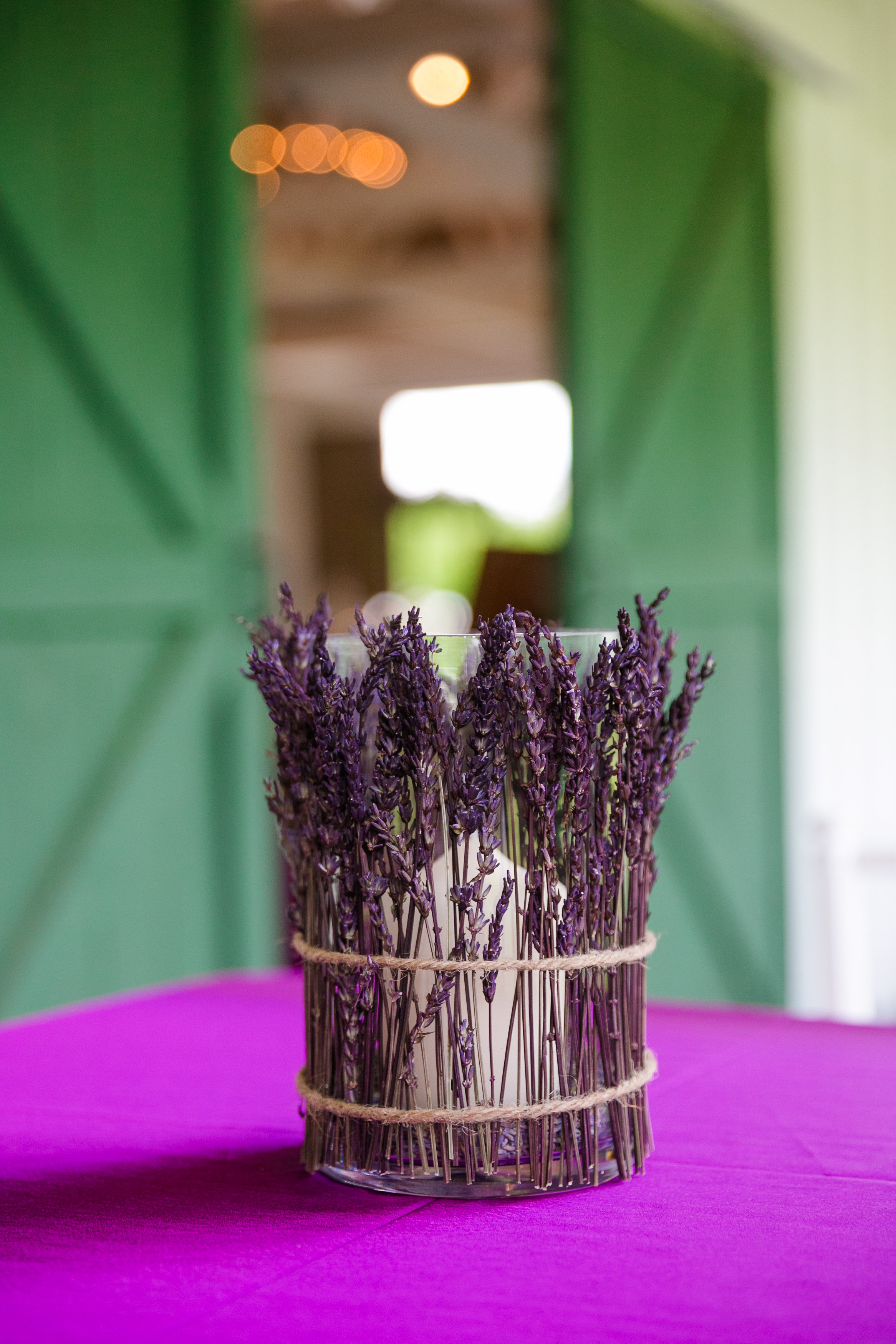 lavender-candle-centerpieces-wedding-reception-barn-decor-rustic-chic-sweetgrass-social-wildberry-farm-dana-cubbage