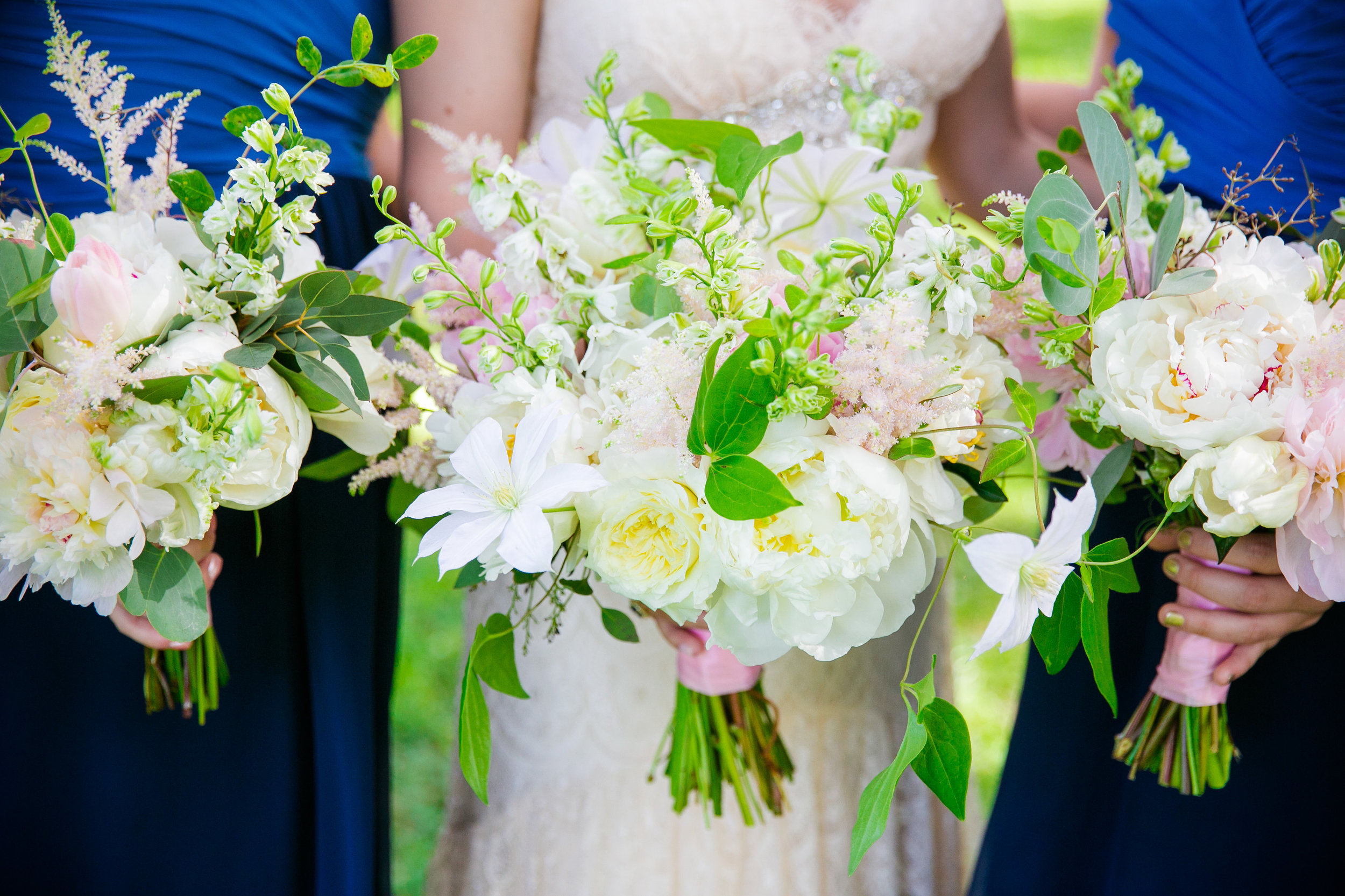 royal-blue-bridesmaids-dresses-with-white-and-blush-pink-bouquets