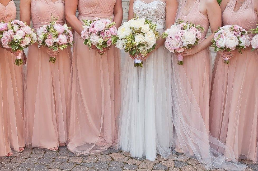 blush-bridesmaids-dresses-with-juliet-blush-rose-bouquets