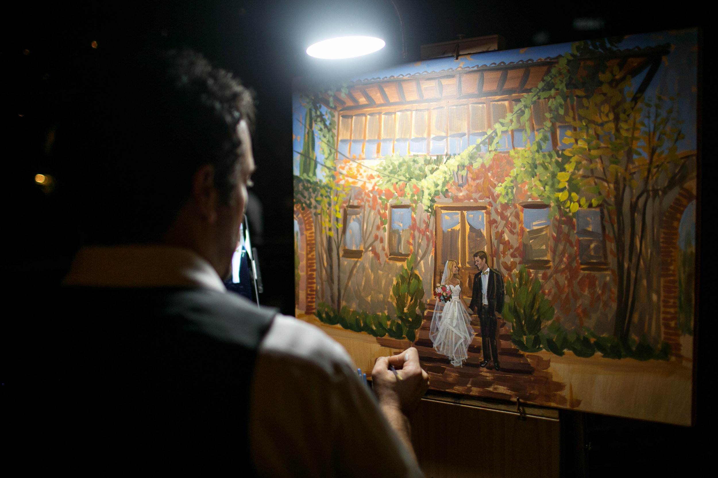 Live wedding painter, Ben Keys, adding the details to Kelsey + Eric's ceremony painting at Summerour Studio in Atlanta.