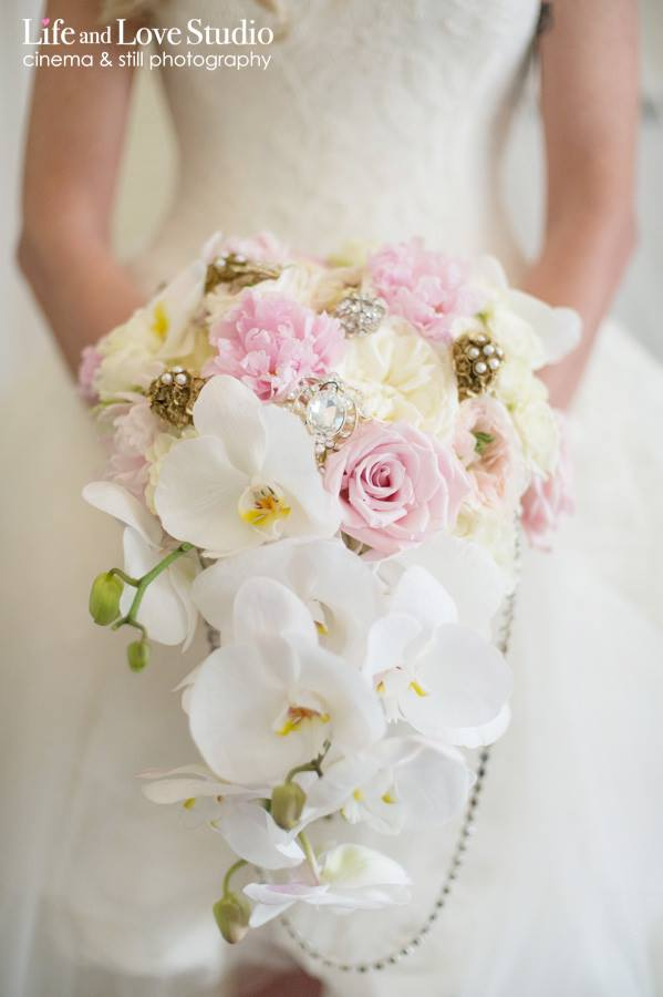 high-low-wedding-gown-with-cascading-orchid-bouquet