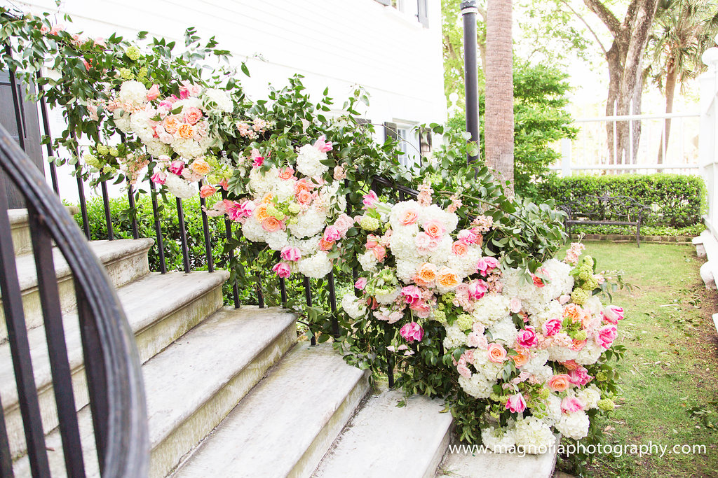 wedding-flowers-down-railing-florals-on-steps