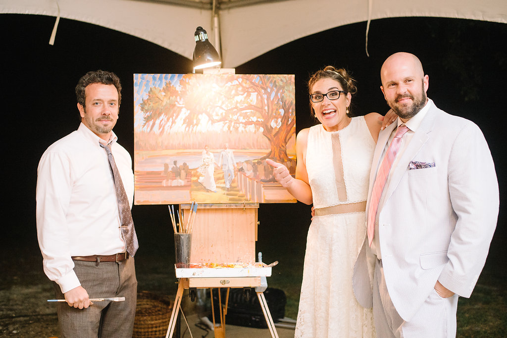 Thanks so much to Aaron + Jillian Photography for capturing this photo of the sweet bride and groom with their live wedding painting!