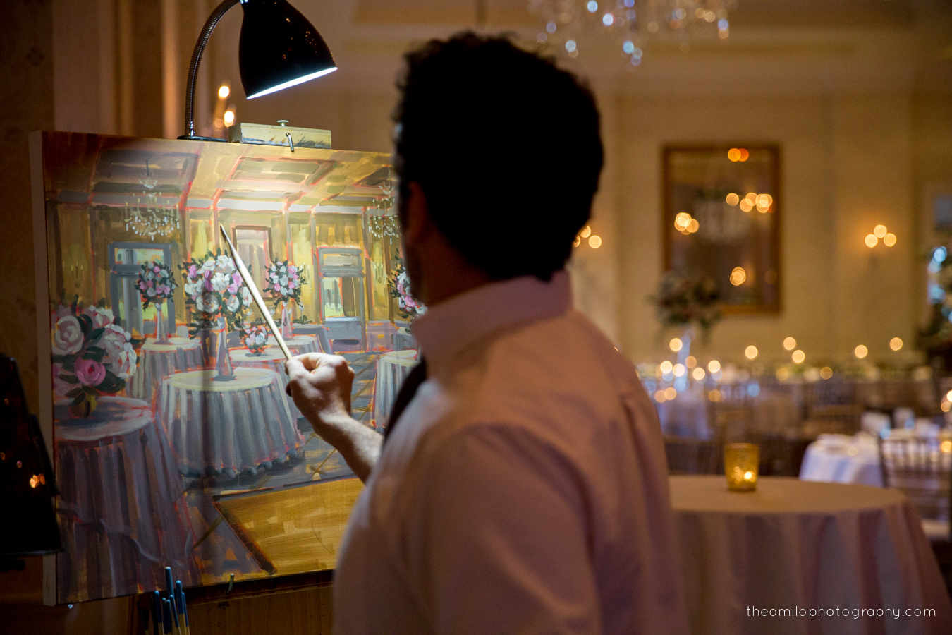 Ben capturing E+D's wedding reception with a live painting at Wilmington's Cape Fear Country Club.