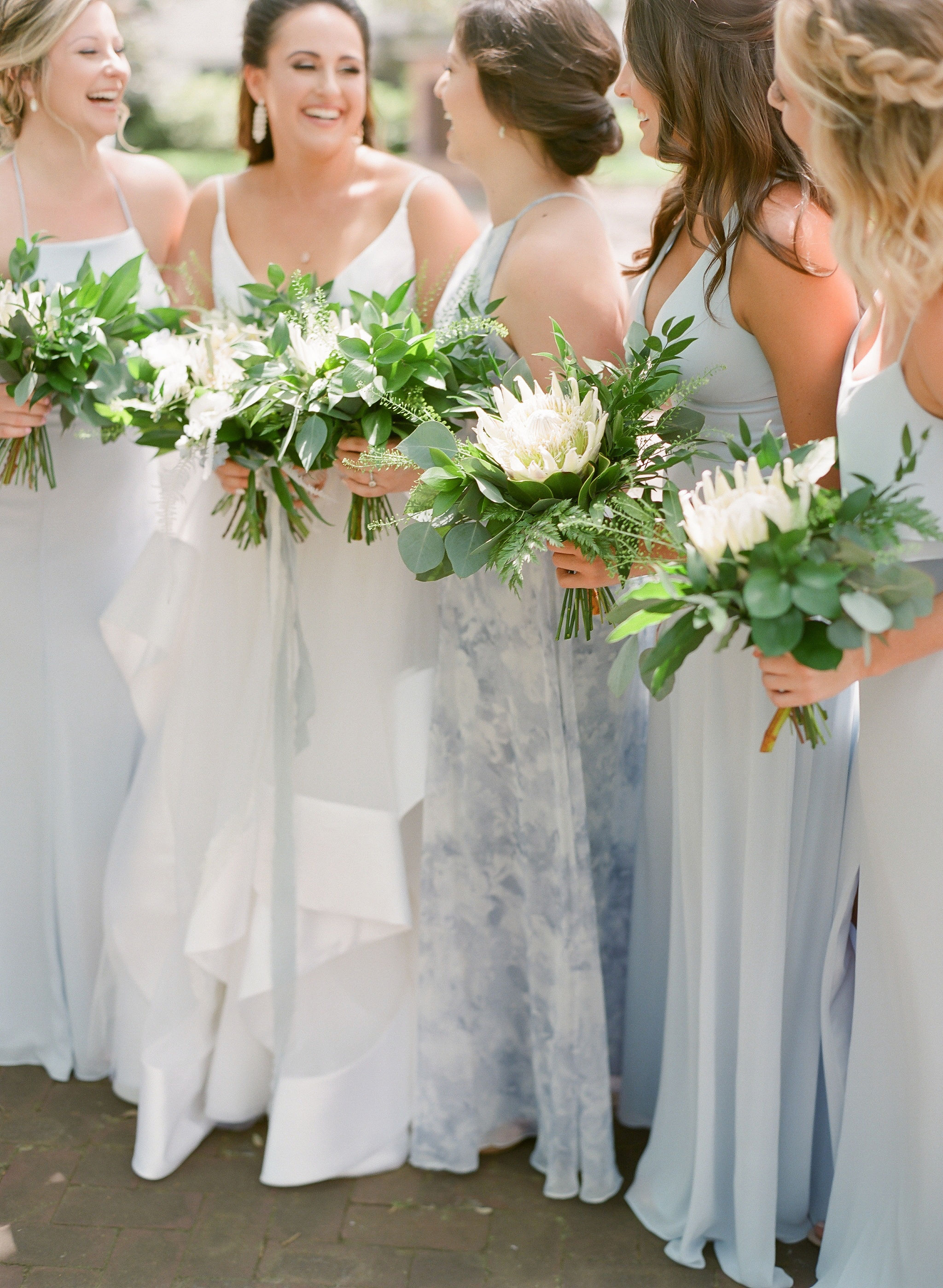 protea-wedding-bouquet-periwinkle-bridesmaids