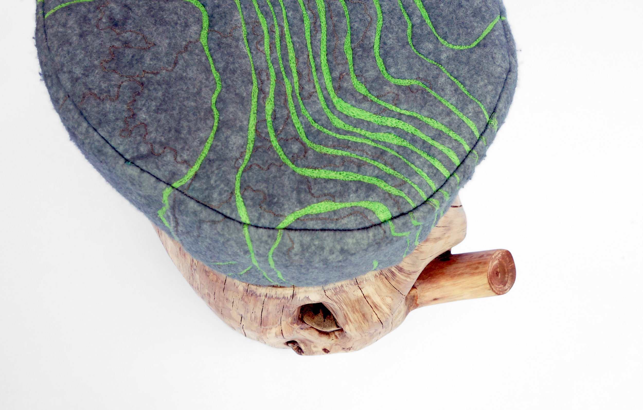 tree stump, felt, thread, industrialized foam    Photographed by: Nicholas Baker