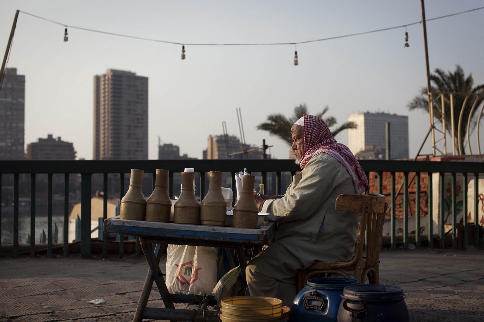 A local sells homemade pots at his roadside stall beside the Nile river.