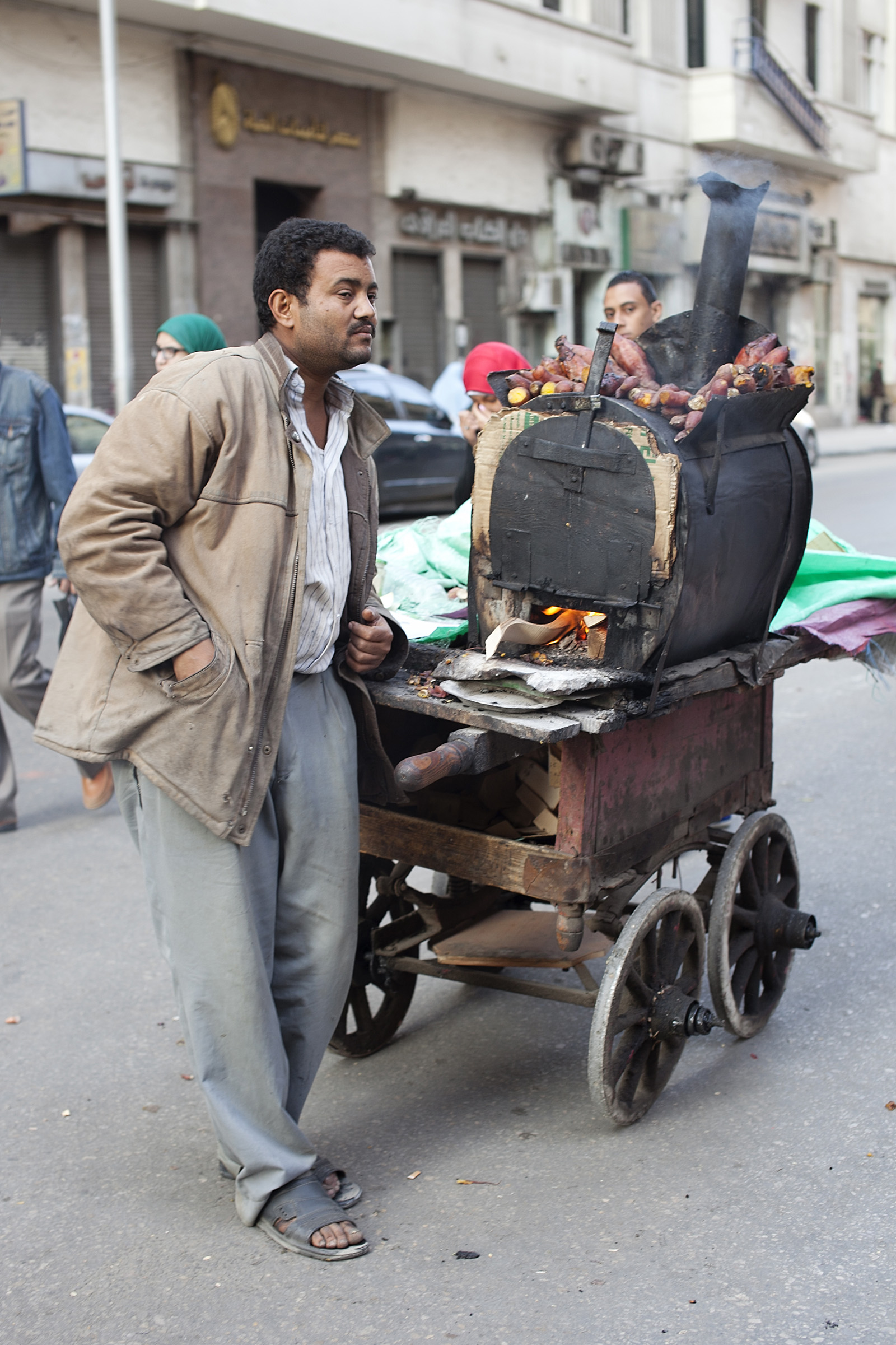 Street food stalls offer fresh roasted sweet potatos and chestnuts in Cairo.