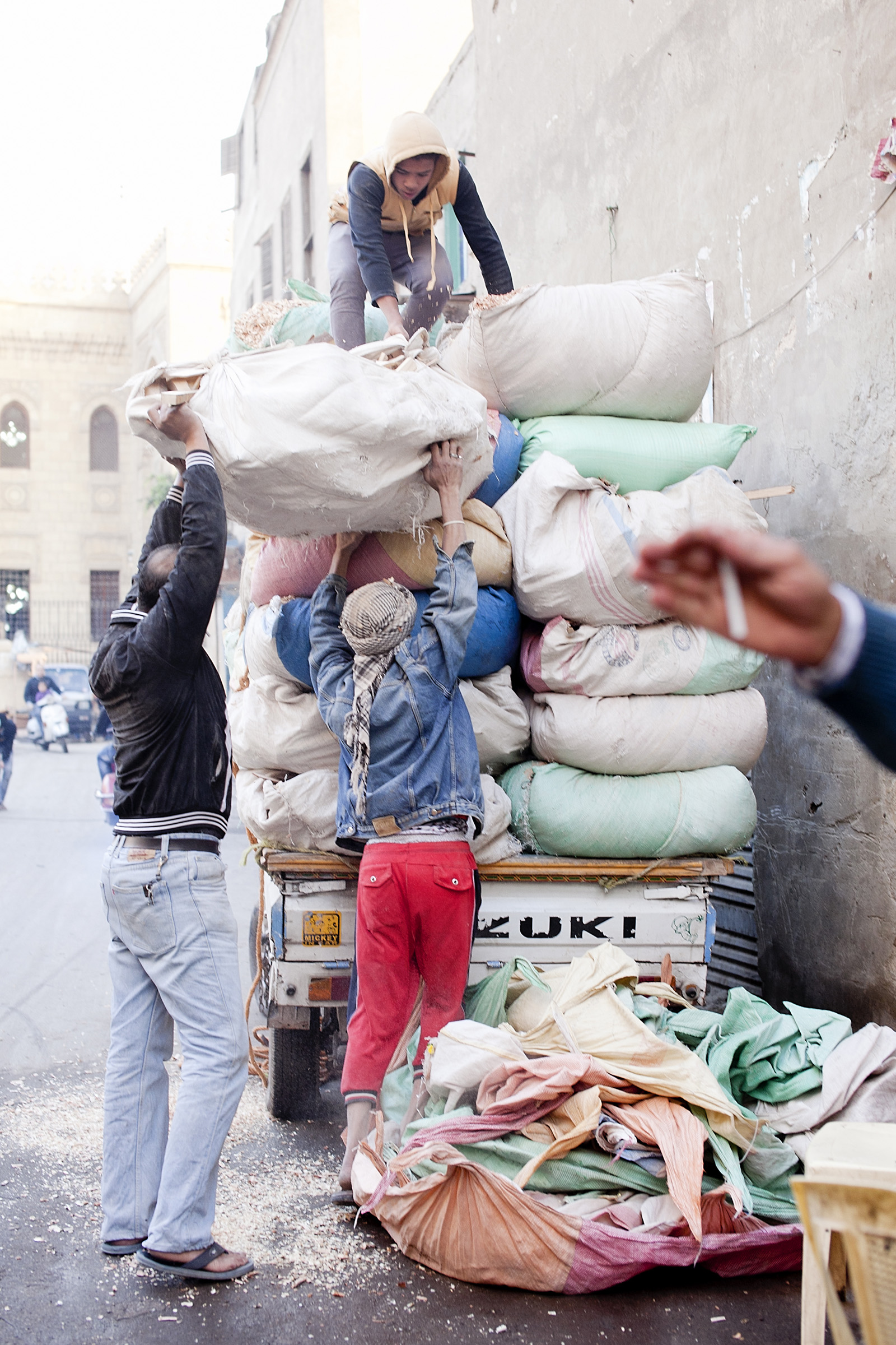 Overloaded trucks like this are a common sight at Cairo's markets.