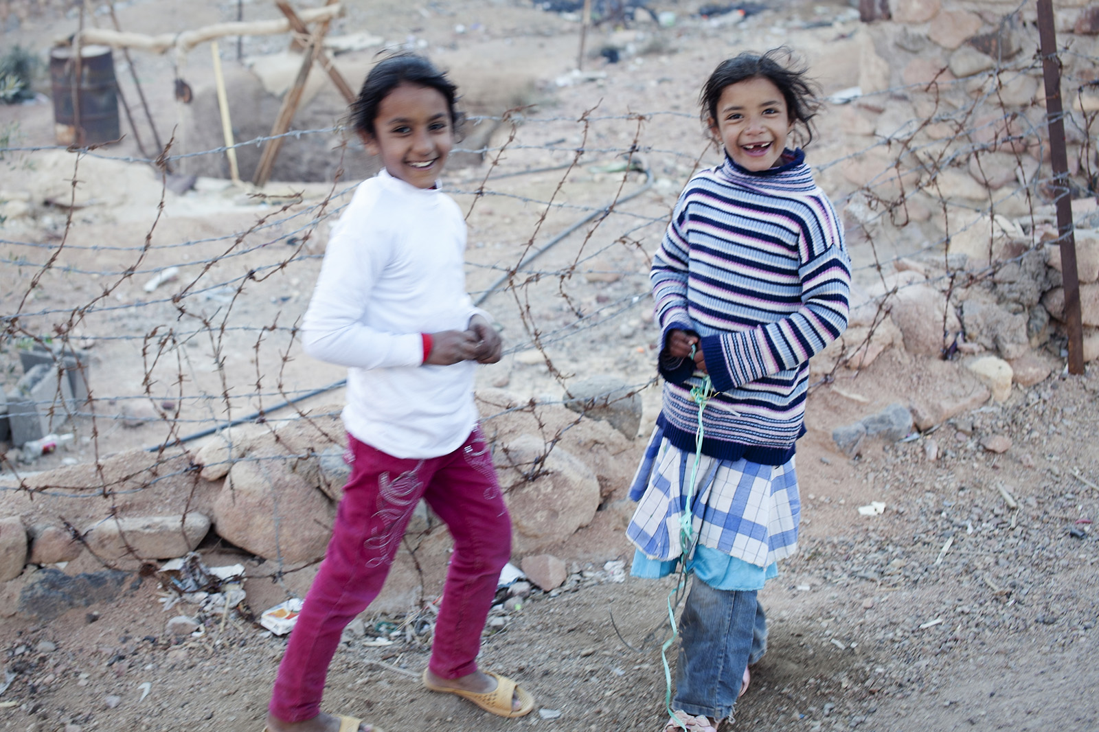Village girls play in the town at the bottom of Mt Sinai.
