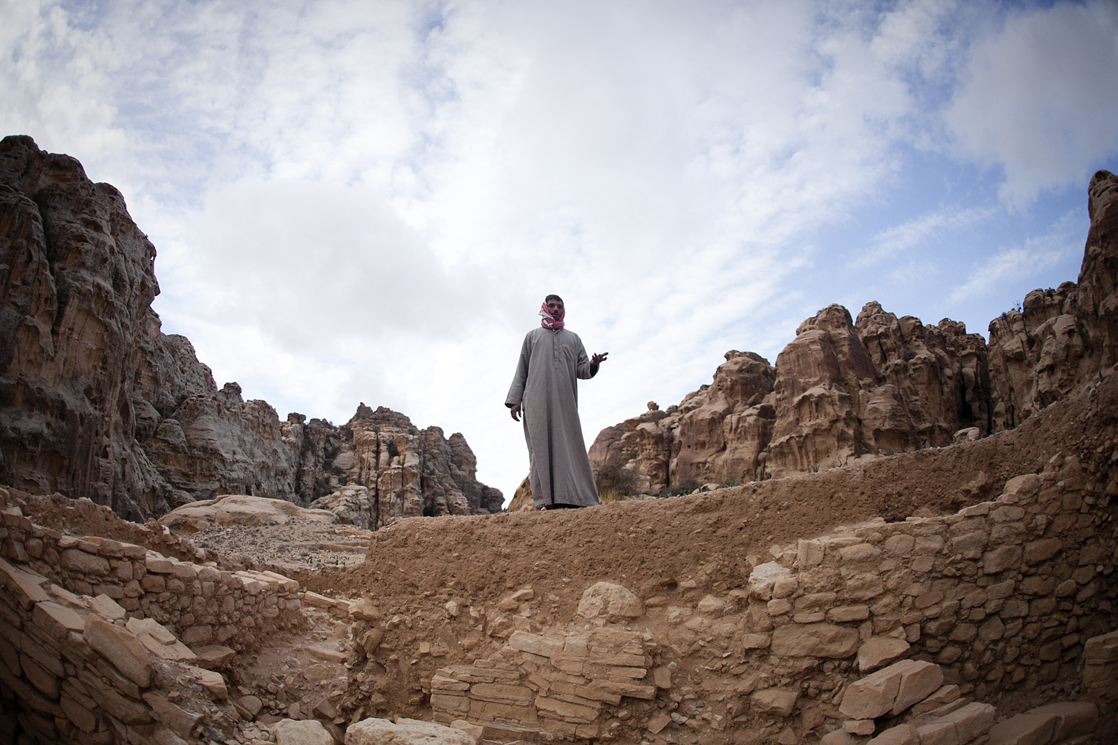 Our guide shows us ancient ruins at the top of a mountain near Little Petra.