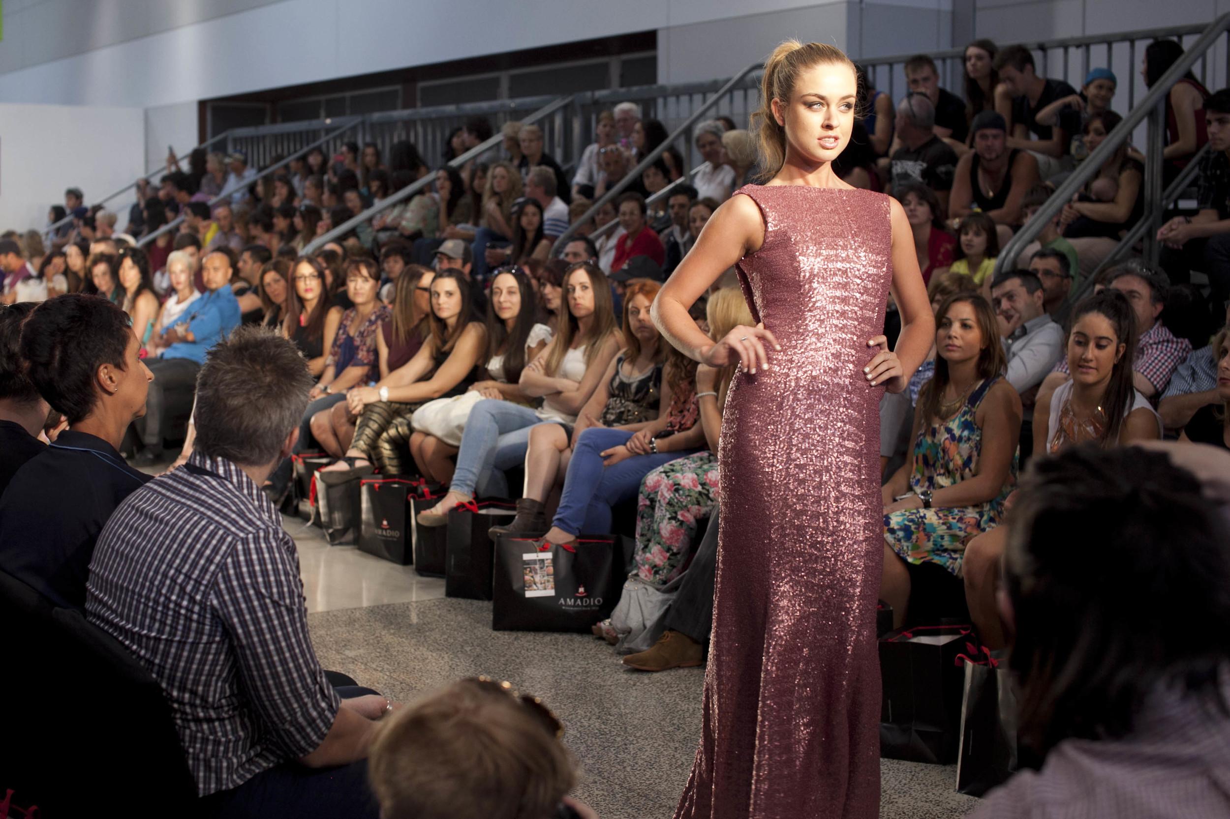 Finesse model Madz Ando wears a couture+love+madness dress in Cristina Tridente's signature glitzy style.