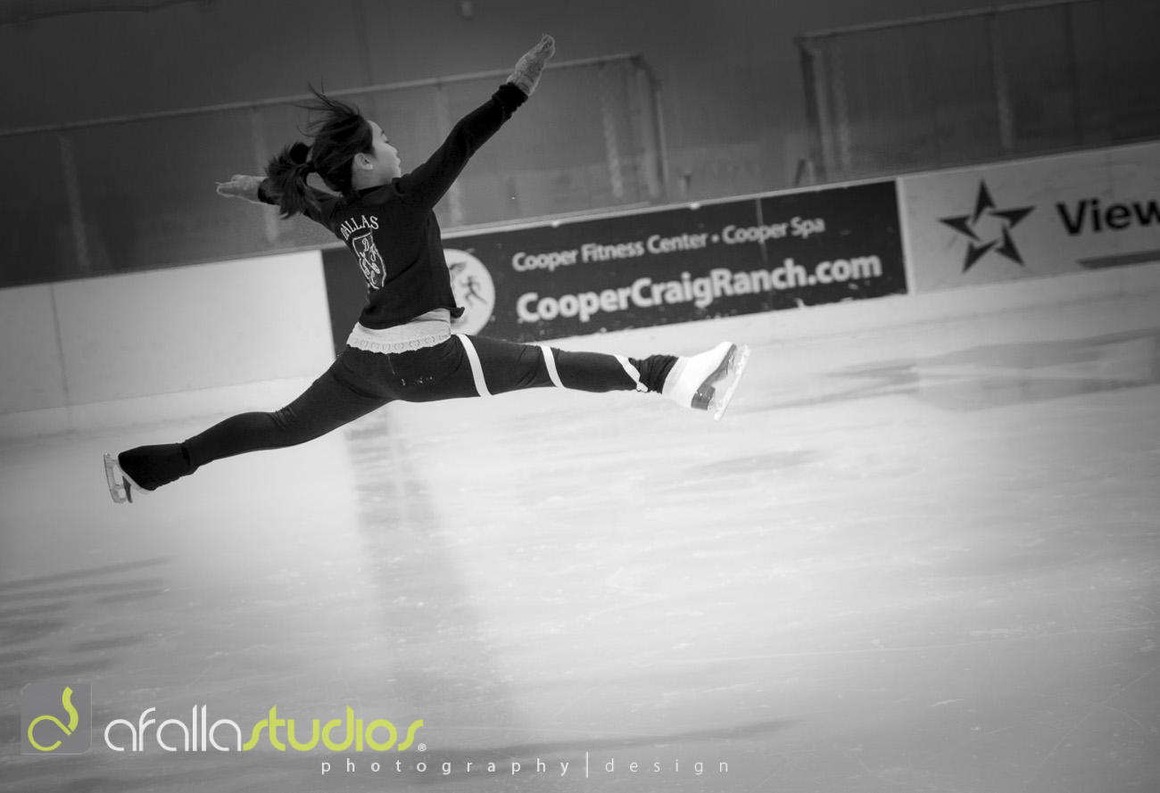 Jenny Wey demonstrating a split jump.