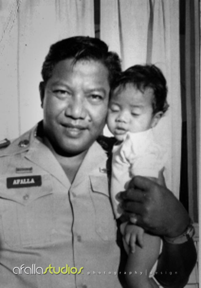 Dad holding me in his arms before going to war in Vietnam. By the time he came home, I didn't even know who he was because he was gone for such a long time.