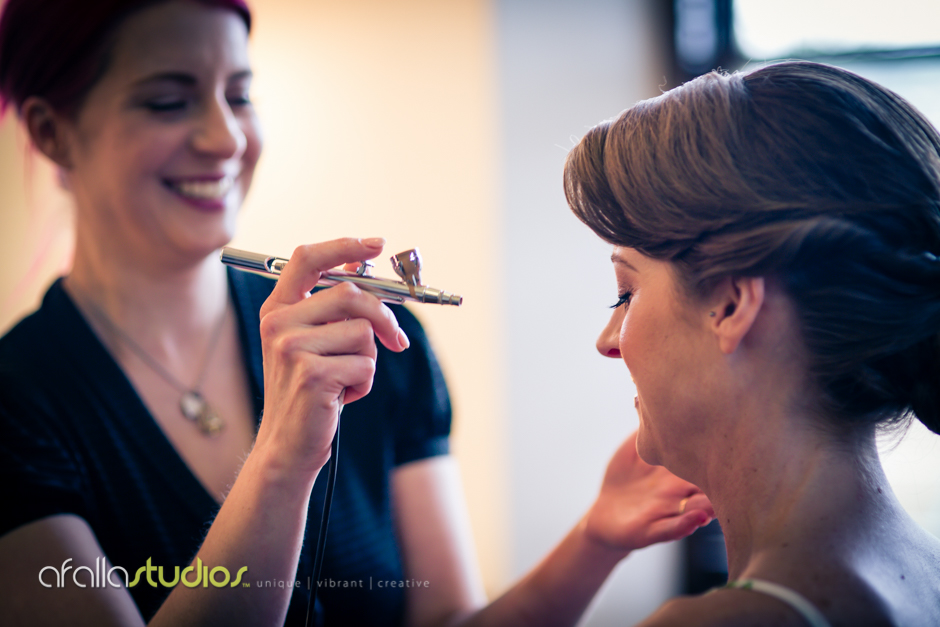LaDonna Stein applying last minute touch up on one of our beautiful clients.