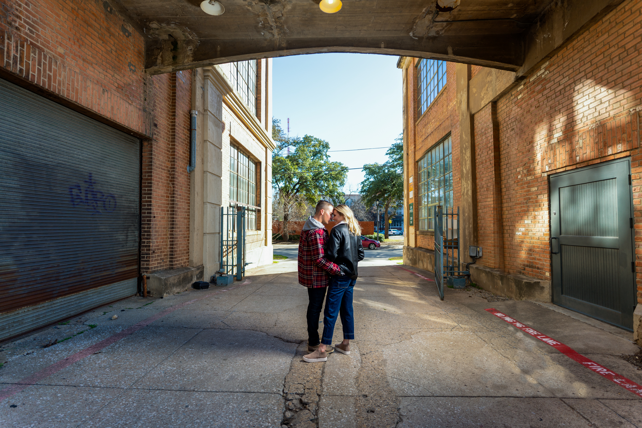 Ashley and Dalton in an embrace while walking through an ally in Deep Ellum, a small part of Downtown, Dallas.