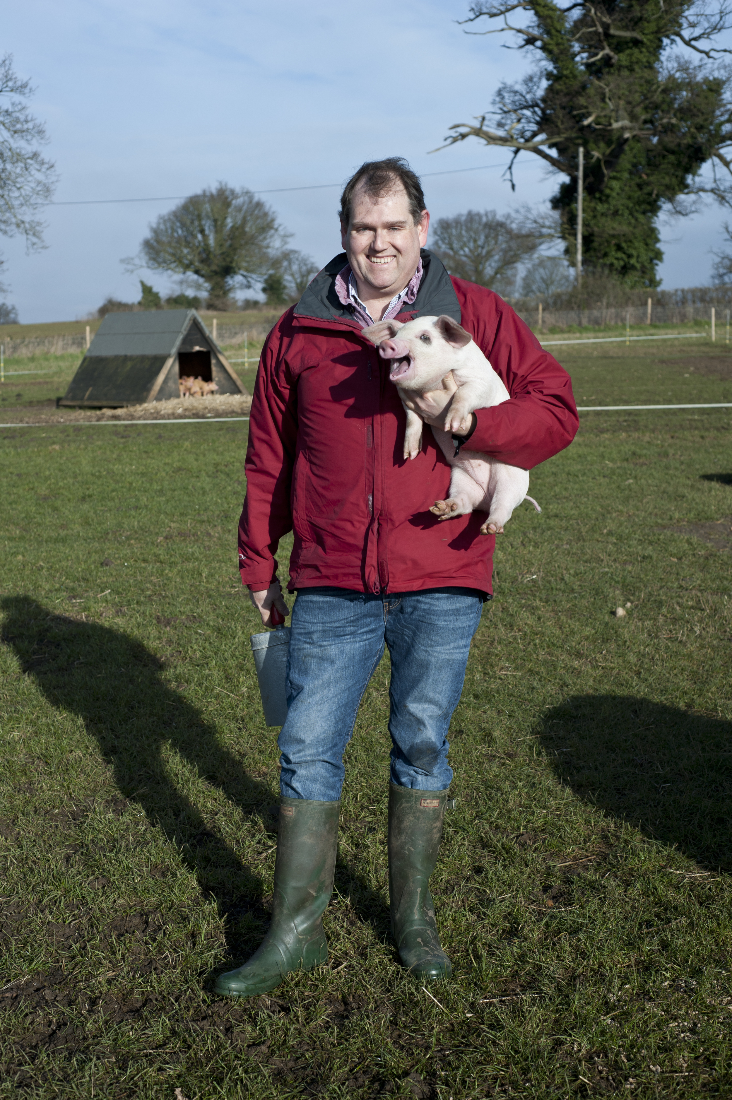 Adrian Melrose with a young free-range piglet.