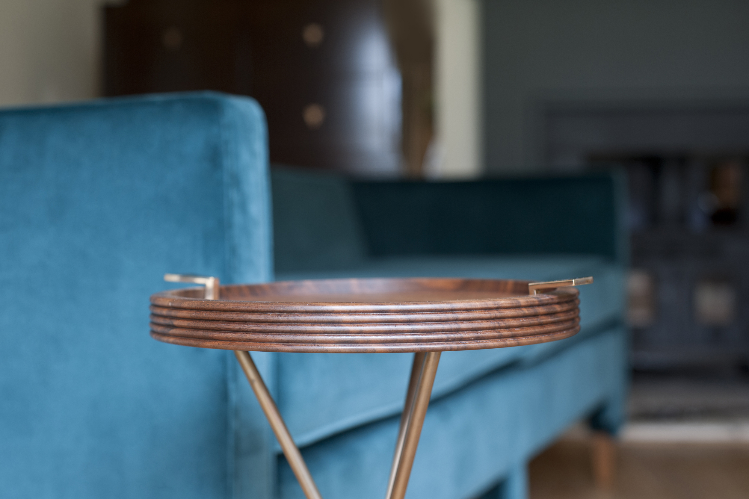Walnut and bronze drinks table.