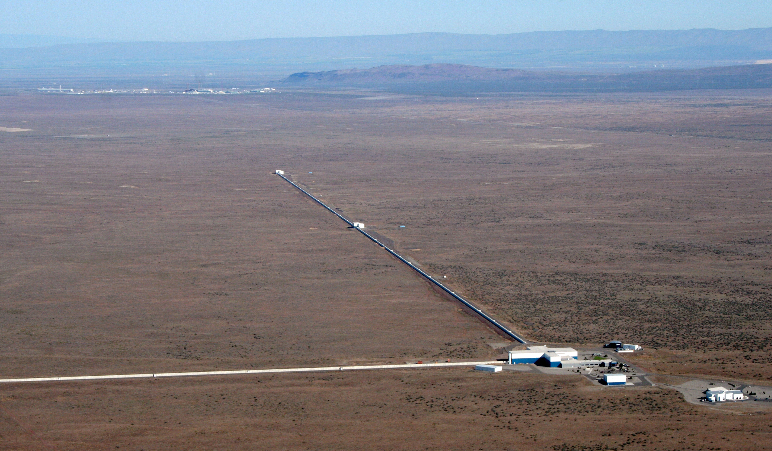 """The LIGO gravitational wave detector - the strongestgravitational waves that we hope to observe will themove mirrors at each end of the """"arms"""" by a distance that is a billion times smaller than the diameter of a typical atom."""