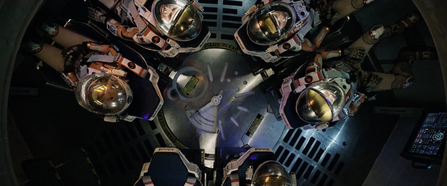 The crew leaving Mars. With one of the astronauts missing. Not a spoiler, since you know that from the trailer.
