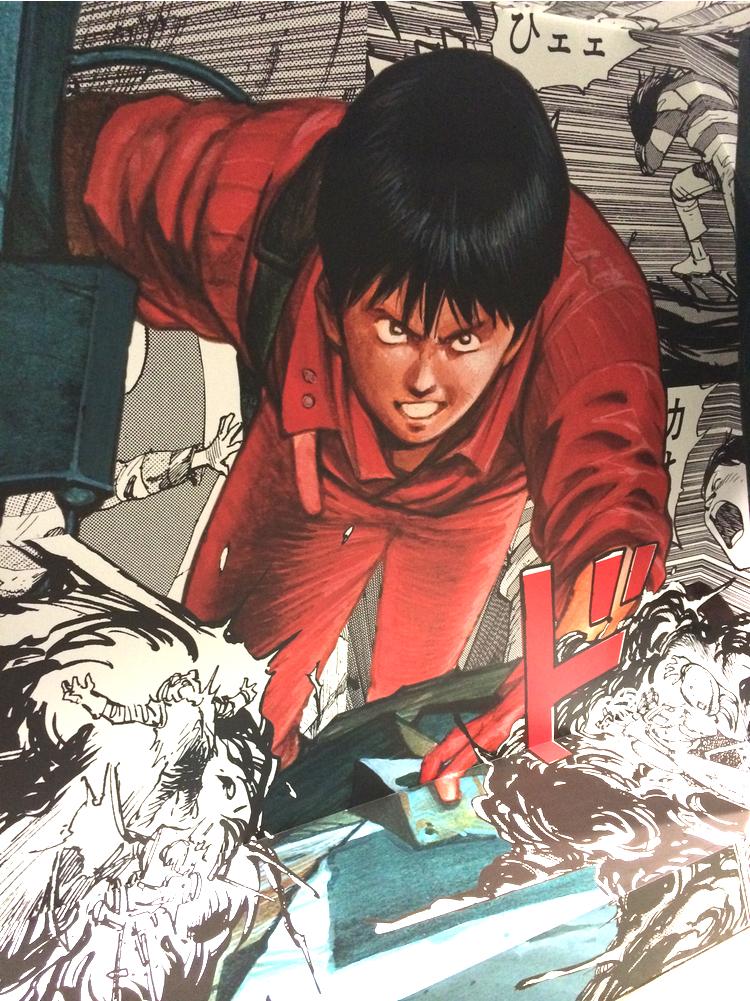 Seriefiguren Akira pryder utsidan på Comme des Garcons Aoyama-butik.