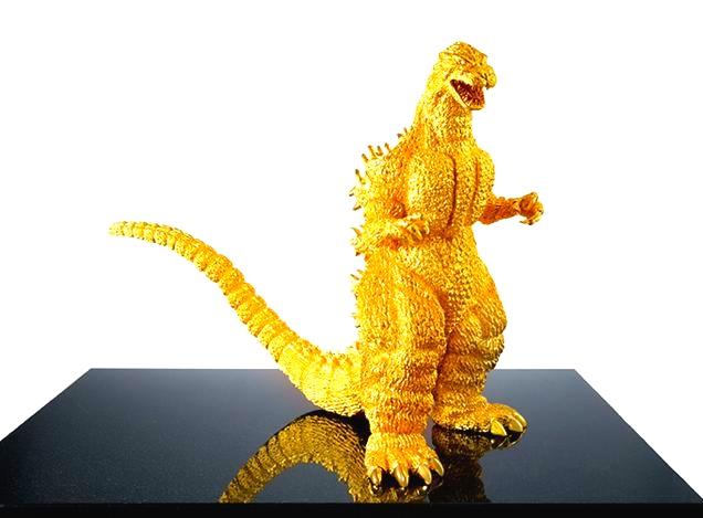 En juvelerarfirma i Ginza har gjort en statyett av Godzilla i 24-karats solitt guld. Har du 10 miljoner över, så kan den bli din. Filmmonstret är i den här versionen Copyright TOHO Co., Ltd.