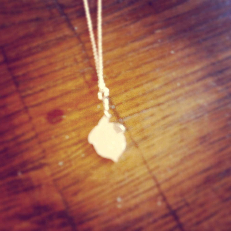 Rose gold acorn necklace.
