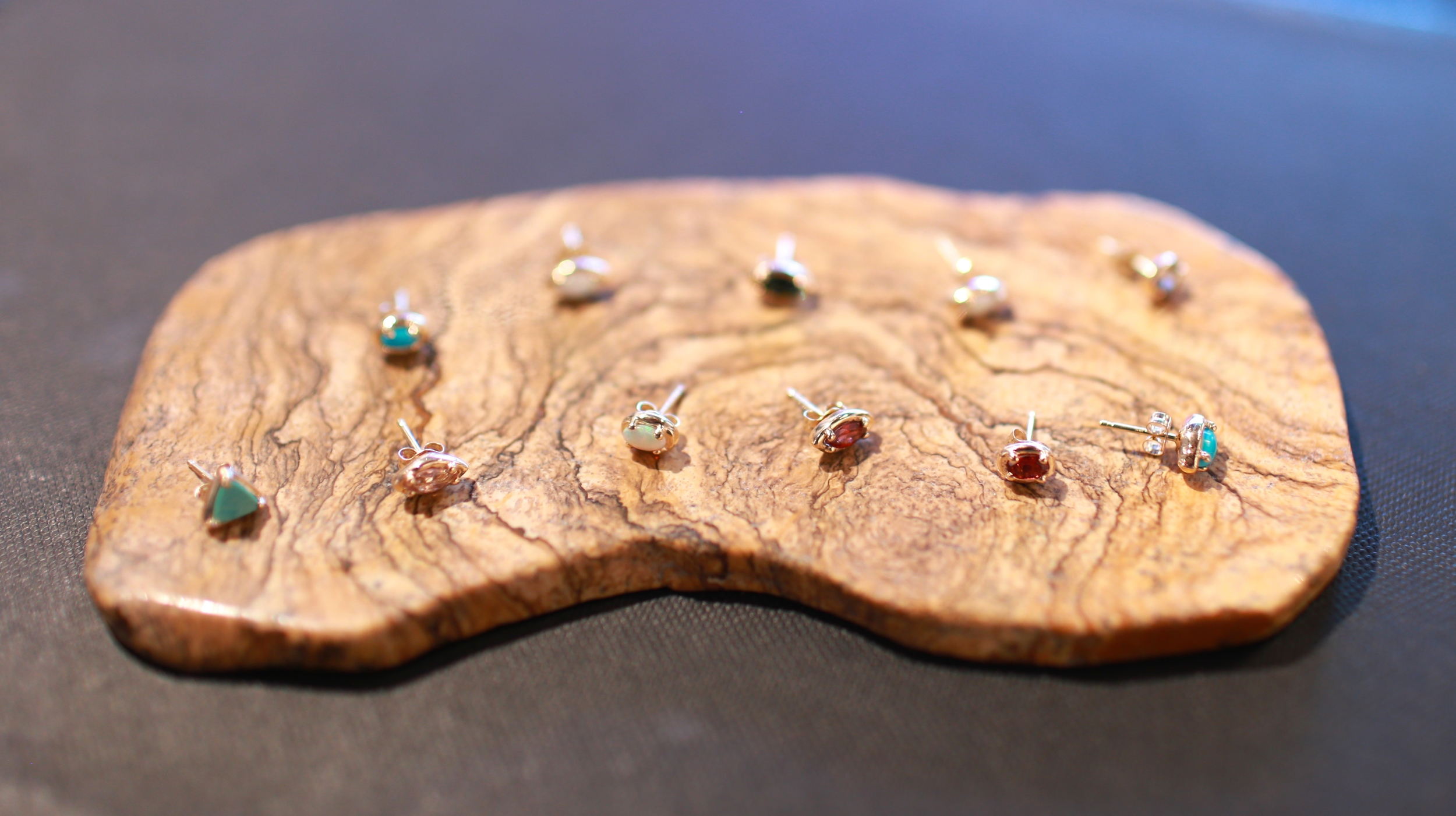 Some of the newest designs of mix-n-match fine ear studs, made with yellow and rose 14k gold and precious stones.