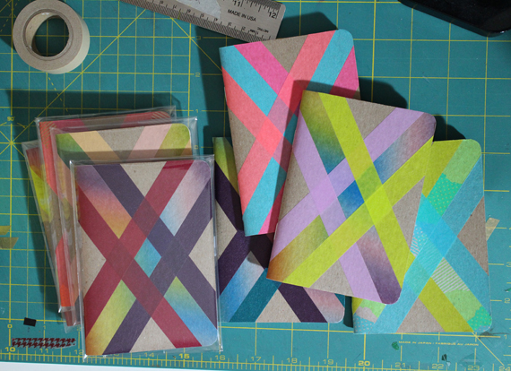 Packaging up notebooks adorned with washi tape.