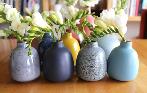 I added some more bud vases to my collection. At the Sausalito store there are often samples with special glazes that never reach the rest of the product line. It's one of the reasons I started collecting the vases. The vase on the left is an example of a special glaze.