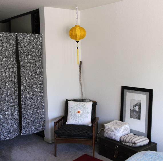 Reading nook with newly sewn curtains and a newly hung lamp. Art in photo by  Alex Shepard