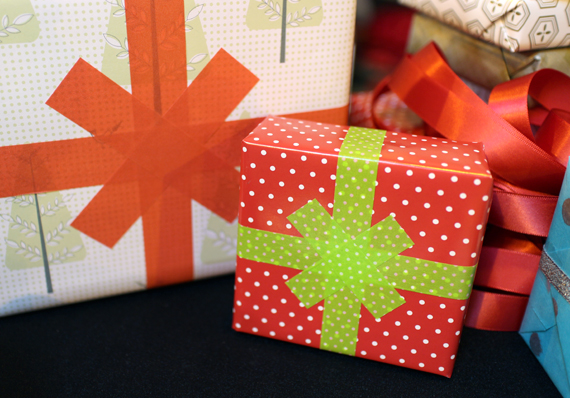 Tape is a great way to make a faux bow that will hold up when shipping presents in the mail.