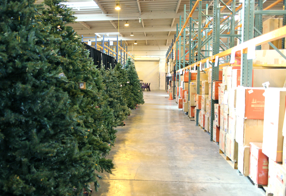 Behind the showroom walls open box trees are ready to go on the floor at a discount.