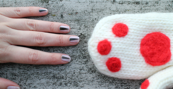 I used tape to mask off my nails to create the slivers of claw. My paws were created by needle felting little red felt patches to an existing pair of mittens.