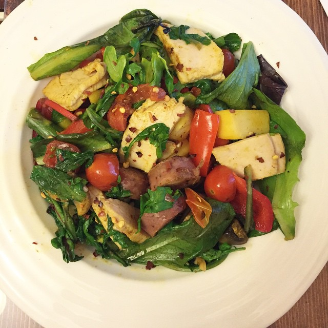 Hot salad with stir fried veggies, chicken sausage, and spinach! Awesome, healthy meal from FitCakery.com