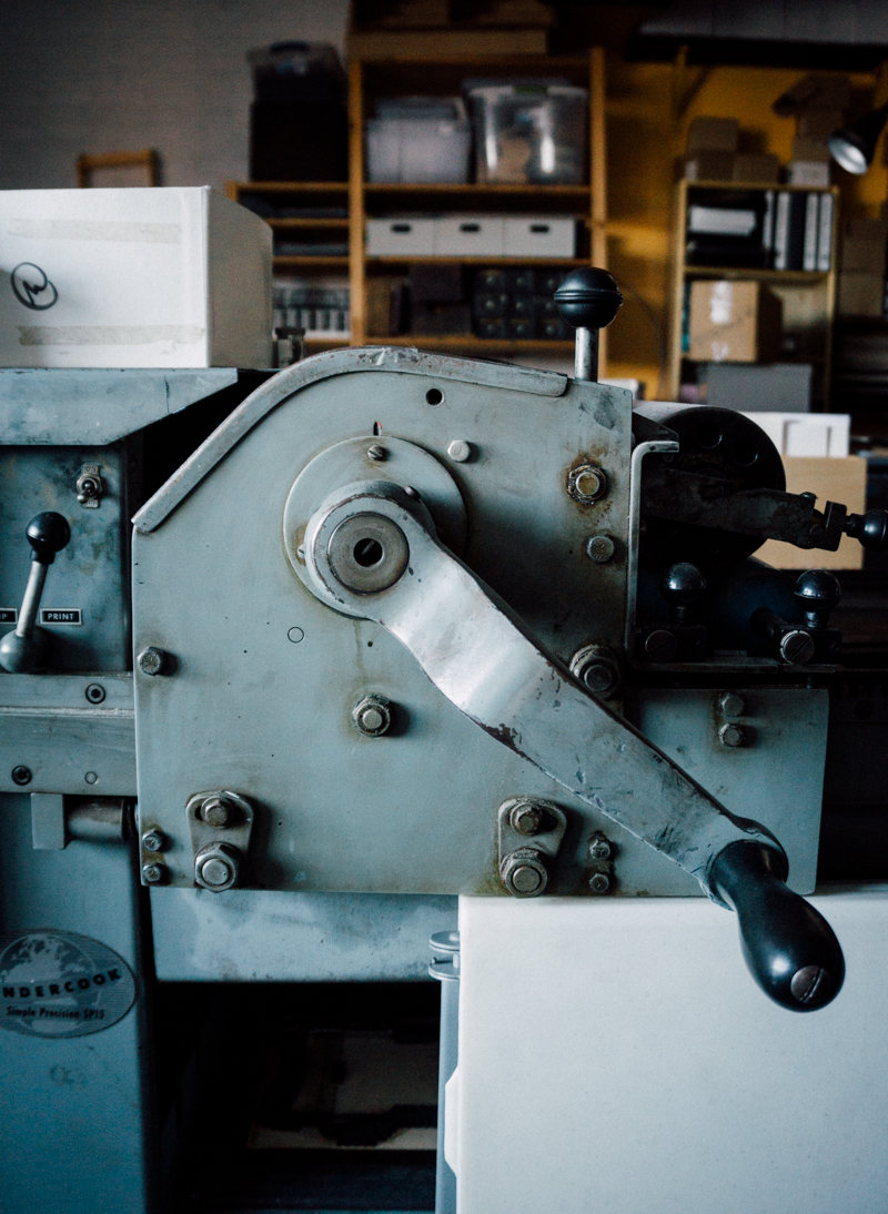 One of several hand operated presses used to print cards and custom jobs.