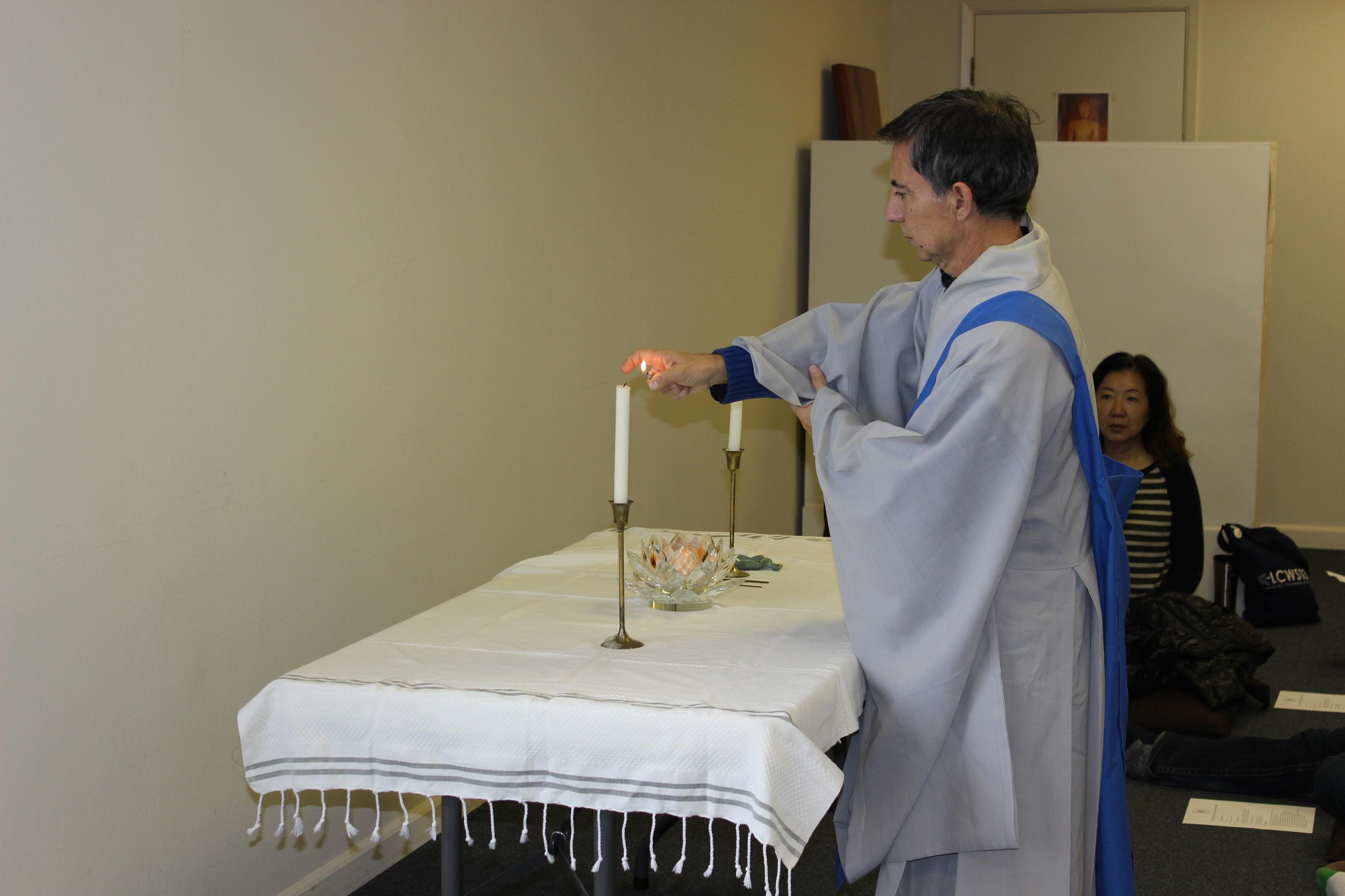 Juan Velasco lighting the candles