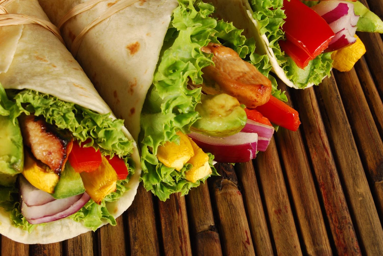 Several chicken wrap sandwiches on mat.jpg